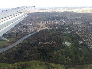 Gunnersbury Park - Aerial view of Kew Royal Botanic Gardens with Gunnersbury Park in the distance.