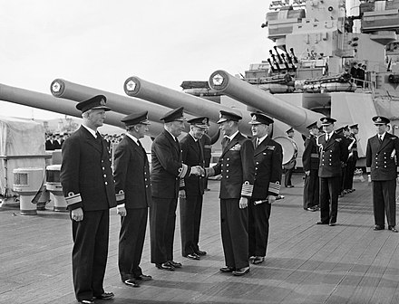 King George VI and Admiral Bruce Fraser aboard HMS Duke of York at Scapa Flow, August 1943 HM King George VI greeting the Flag Officers of the Home Fleet on board the flagship HMS DUKE OF YORK at Scapa Flow, 16 August 1943. A18577.jpg