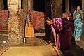 Hampi, India, Hindu women in Virupaksha Temple at night.jpg
