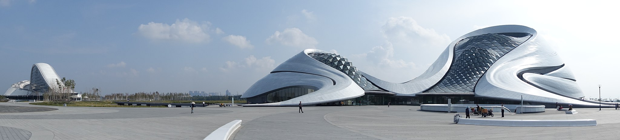 Harbin Grand Theatre, designed by MAD Studio. Located in Harbin's Songbei District, the opera house is surrounded by wetlands and waterways of Songhua River. Harbin Grand Theatre Pano 201609.jpg