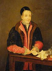 A coloured painting showing a man in a cap and black gown over red clothes with writing materials on a table in front of him