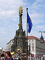 Holy Trinity Column in Olomouc with flag.jpg