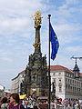 Holy Trinity Column in Olomouc with flag.jpg