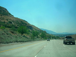 """<a href=""""http://search.lycos.com/web/?_z=0&q=%22Interstate%20215%20%28Utah%29%22"""">Interstate 215</a> as it passes along the eastern side of Holladay"""