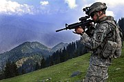 ISAF soldier looking for enemy positions in Kunar Province of Afghanistan