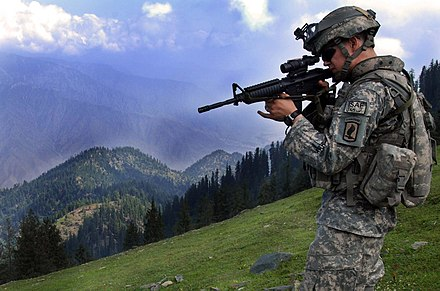 NATO International Security Assistance Force in Afghanistan ISAF soldier looking for enemy positions in Kunar Province of Afghanistan.jpg