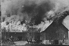 Large barn, with its roof ablaze