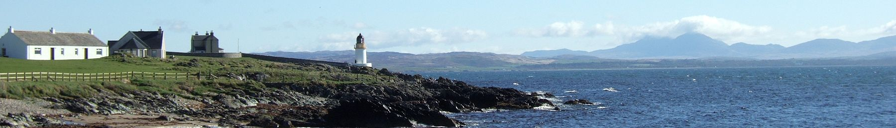 "Loch Indaal from Port Charlotte looking across Islay to the ""paps"" of Jura."
