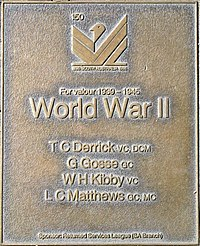 an image of a bronze plaque listing highly decorated service personnel of World War II