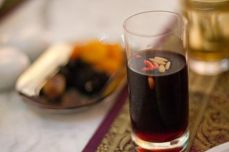 Grape syrup - Jallab syrup made from carob, dates, grape molasses and rose water; used to make jallab tea