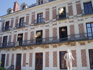 "Jean Eugène Robert-Houdin - This is the public ""dragons"" display at Jean Eugène Robert-Houdin's house in Blois, which has been turned into a museum. The ""dragons"" move in and out of the windows in a theatrical display. A statue of Robert-Houdin is at lower right."