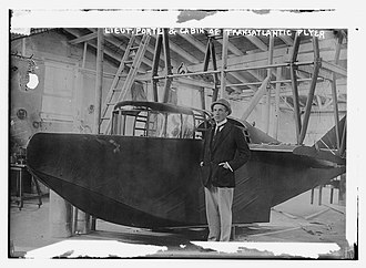 "John Cyril Porte - In the Curtiss factory with the second prototype designed under Porte's supervision;  appearing in The Sun 18 June 1914, ""The latest photographs of the Wanamaker seaplane. Lieut. Porte standing by the machine."""