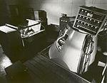 John Glenn in the Mercury Procedures Trainer (9457842545).jpg