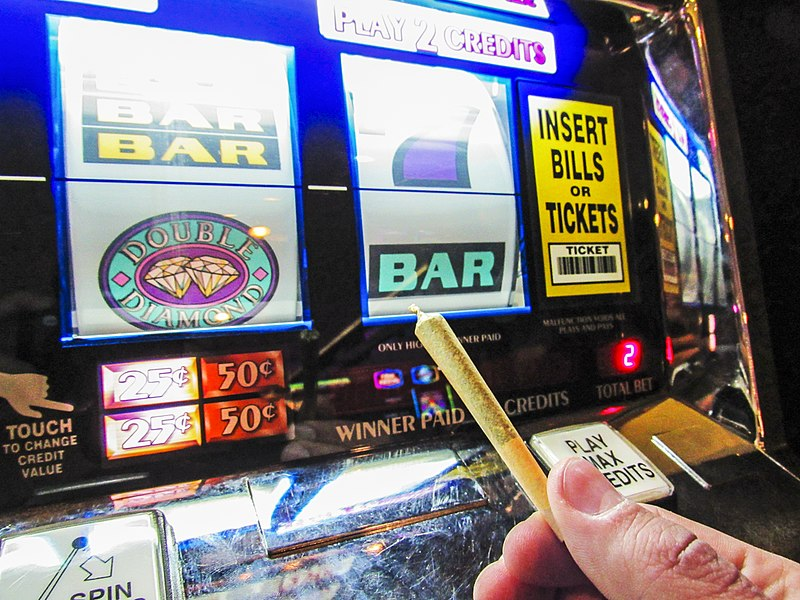 File:Joint in front of slot machine.jpg