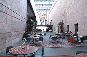 Joslyn Art Museum - The museum's glass atrium (the west view) contains a café and gift shop. Dale Chihuly's Chihuly: Inside and Out is seen at the far end.