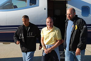 Juan Carlos Ramírez Abadía - Juan Carlos Ramirez Abadia, escorted by two DEA agents after being extradited from Brazil.