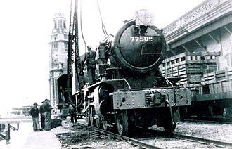 Kowloon–Canton Railway - 77509 being unloaded at Hong Kong (1947)