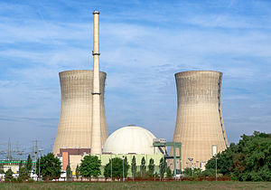 Nuclear power plant - A Nuclear Power Station (Grafenrheinfeld Nuclear Power Plant, Grafenrheinfeld, Bavaria, Germany). The nuclear reactor is contained inside the spherical containment building in the center – left and right are cooling towers which are common cooling devices used in all thermal power stations, and likewise, emit water vapor from the non-radioactive steam turbine section of the power plant.