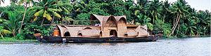 Kettuvallam - A kettuvallam houseboat with an upper deck