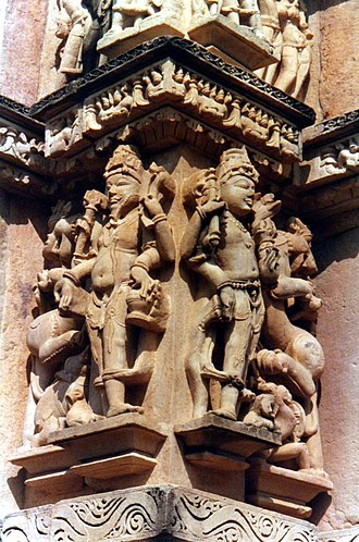 Guardians of the directions - Parshvanatha Temple, Khajuraho, the southeast corner, with guardians Indra (E) and Agni (SE).