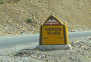 Prevention of HIV/AIDS - Know Aids – No Aids road sign in Spiti Valley, Himachal Pradesh, India, 2010