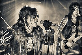 Phil Lewis (left) performing with L.A. Guns in 2010