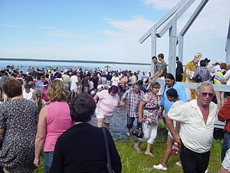 Alexis Nakota Sioux First Nation - Lac Ste. Anne pilgrims enter the waters during the blessing of the lake.