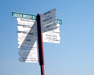 Lakehead University - A bilingual sign. The languages are English and Anishinaabe.