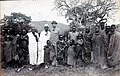 Later chief Meli as boy standing next to Dr.Hans Meyer visiting the Meli family before his Kilimanscharo ascent.jpg