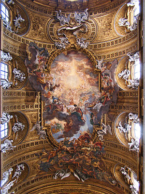 Illusionism (art) - Triumph of the Name of Jesus, by Giovanni Battista Gaulli, on the ceiling of the Church of the Gesu. The decorations of the vault over the nave date back to the 17th Century. The fresco is the work of Giovanni Battista Gaulli, known as Baciccia. The stucco reliefs were executed by Ercole Antonio Raggi and Leonardo Reti, following the drawings of Baciccia who wanted to effect a real continuity between painting and sculpture.