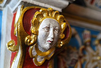 Leicester Guildhall - An angel on the ornate wooden fireplace inside the Mayor's Parlour