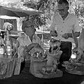 Leo Fesler (seated) with his wood carvings talking with man at third annual Folklife Festival at Zion National Park Nature (e266f8ea36ee412cb81fd1c43c5aaaaa).jpg