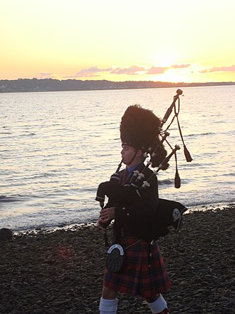 Woodwind instrument - A piper playing the bagpipes in Newport, Rhode Island.