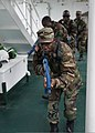 Liberian service members practice room clearing and tactical movement techniques aboard the Spanish Civil Guard patrol ship Rio Segura March 8, 2014, in Dakar, Senegal, during exercise Saharan Express 2014 140308-N-QY759-077.jpg