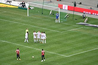 Yohan Cabaye - Cabaye (bottom left) preparing to take a free kick against Lyon in the 2007–08 season