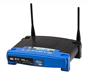 "IEEE 802.11 - This Linksys WRT54GS WiFi router from 2005 operates on the 2.4 GHz ""G"" standard, capable of transmitting 54 megabits per second."