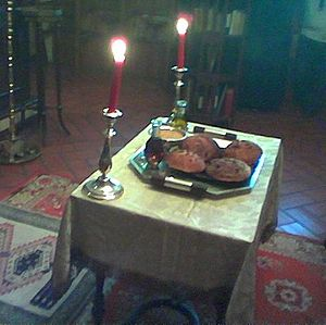 Vespers - Table set with five loaves, wheat, wine and oil for artoklassia.