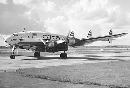 TWA L-749A Constellation at Heathrow in 1954 with an under fuselage &quotSpeedpack&quot freight container - Lockheed Constellation