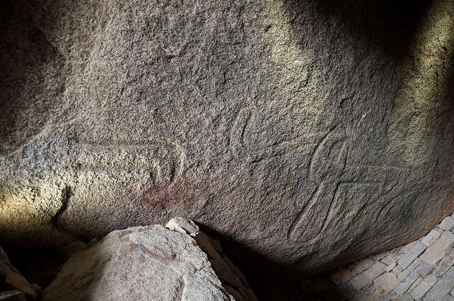 The engraved capstone of the 'Table des Marchand' dolmen in Locmariaquer (Morbihan, Brittany, France). The carved motives are, from right to left: a hafted axe, a crook, and an incomplete bovine. This huge orthogneiss slab was broken. The upper bit was found in the Gavrinis dolmen.
