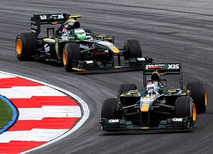 Team Lotus (2010–11) - Jarno Trulli leads Heikki Kovalainen during practice for the 2010 Malaysian Grand Prix.