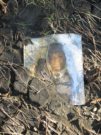 Lower Ninth Ward - Damaged photo in flood silt. Remains of ruined possessions were common on the streets of the Lower 9th Ward for months after the floodwaters had been drained.