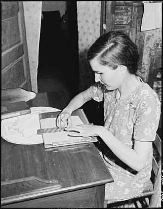 Lucy Sergent, 26-year-old daughter of a Kentucky coal miner, writing with a slate and stylus in 1946. Blind from birth, she attended the Kentucky School for the Blind for 11 years. Lucy Sergent, 26, who has been blind since birth, writing. She attended the Kentucky State School for the Blind for... - NARA - 541365.jpg