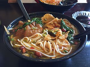 Luosifen - A bowl of Luosifen served with pig's trotters in Beijing