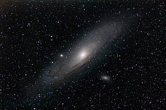 Messier 32 - In this image of the Andromeda Galaxy, Messier 32 is to the left of the center.