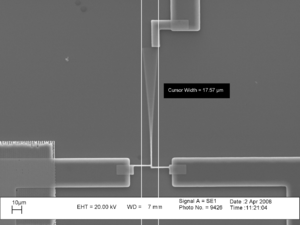 Microelectromechanical systems - MEMS microcantilever resonating inside a scanning electron microscope
