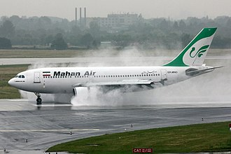 A Mahan Air Airbus A310 using reverse thrust in rainy weather at Dusseldorf Airport Mahan Air A310 EP-MNO.jpg