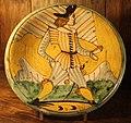 Maiolica di montelupo, piatto con ragazzo e bandiera, 1620-40 ca..JPG