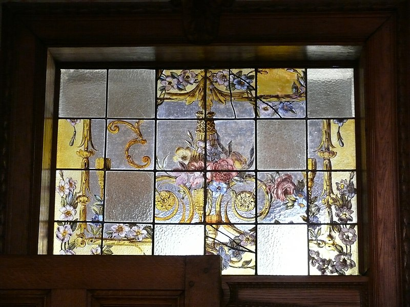 Stained glass window above a door in Renesse castle in Oostmalle, Belgium.