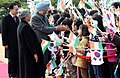 Manmohan Singh and his wife Smt. Gursharan Kaur being welcomed by the children at the President House of South Korea, in Seoul on March 25, 2012. The South Korean President, Mr. Lee Myung-bak is also seen.jpg