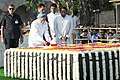 Manmohan Singh paying floral tributes at the Samadhi of Mahatma Gandhi on his 142nd birth anniversary, at Rajghat, in Delhi on October 02, 2011. The Union Minister for Urban Development, Shri Kamal Nath is also seen.jpg